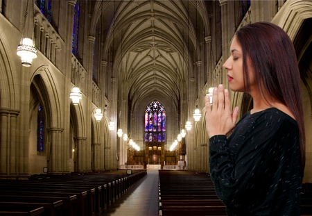Beautiful Hispanic Latino Christian woman in deep prayer photo