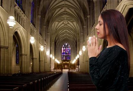 Beautiful Hispanic Latino Christian woman in deep prayer photo