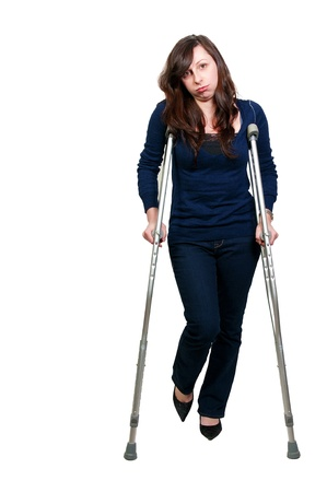 sprain: A beautiful woman using a set of medical crutches to help her walk