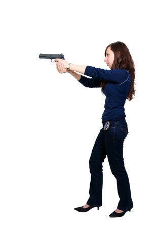 A beautiful police detective woman on the job with a gun Stock Photo - 8891435