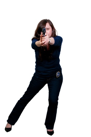 A beautiful police detective woman on the job with a gun Stock Photo - 8891416