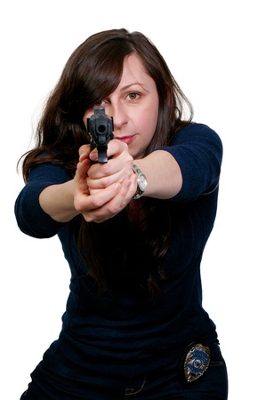 A beautiful police detective woman on the job with a gun Stock Photo - 8892070