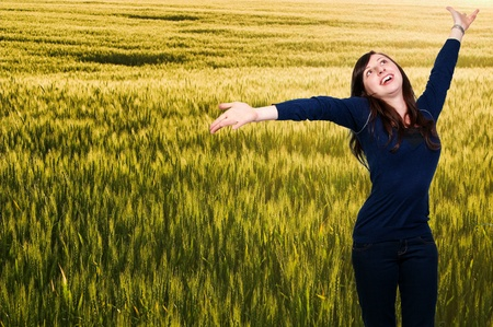 A woman free of allergies standing in a field photo