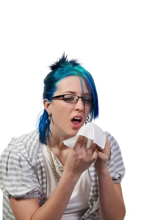 A beautiful woman with a cold, hay fever or allergies blowing her nose Stock Photo - 8892810