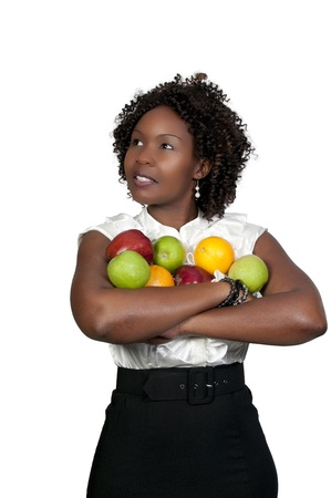 A black woman holding an assortment of fruit Imagens