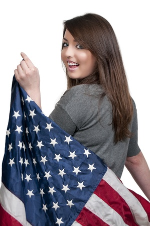 A beautiful young woman wrapped in a flag. photo