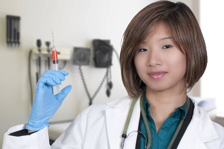 A beautiful young female Asian doctor on her rounds photo