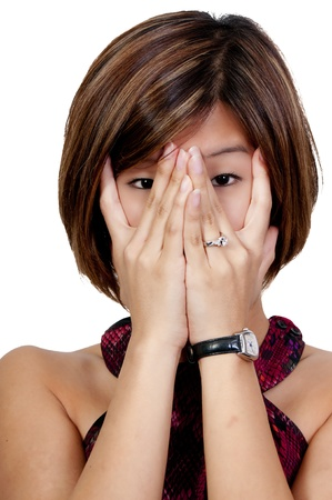 A beautiful young scared or surprized Asian woman looking through her hands Stock Photo - 9586012