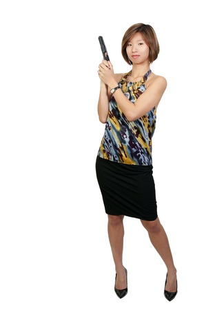 A beautiful Asian female police detective woman on the job with a gun photo