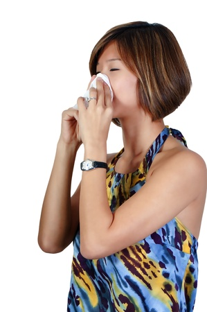 hanky: A beautiful Asian woman with a cold, hay fever or allergies blowing her nose