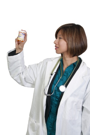 A beautiful young Asian female doctor holding a prescription medicine pill bottle photo