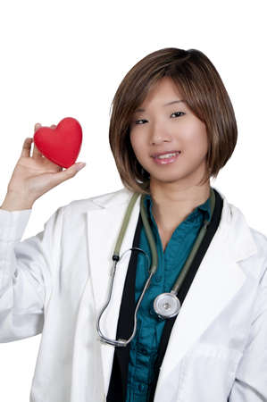 An Asian female cardiologist holding a red heart photo