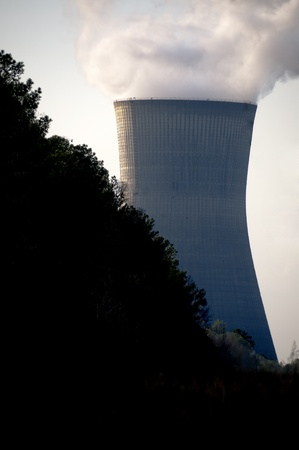 nuclear power plant: View of a nuclear power plant with high tension wires. Stock Photo