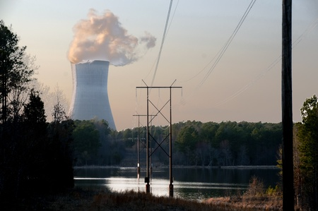electric power station: View of a nuclear power plant with high tension wires. Editorial