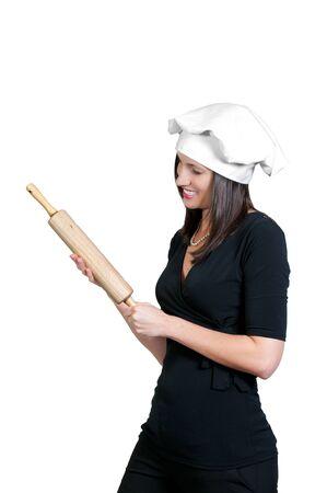 Ein schöner Chef der jungen Frau, der ein Nudelholz anhält Standard-Bild - 9582397