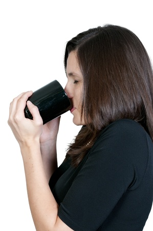 A beautiful young woman drinking coffee in the morning photo
