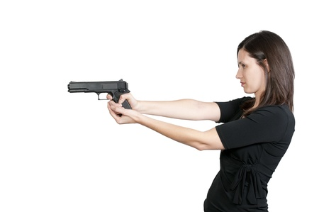 A beautiful police detective woman on the job with a gun Stock Photo - 9578347