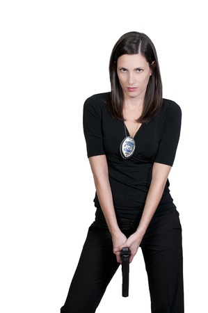 A beautiful police detective woman on the job with a gun Stock Photo - 9578442
