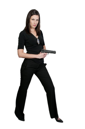 A beautiful police detective woman on the job with a gun Stock Photo - 9578359