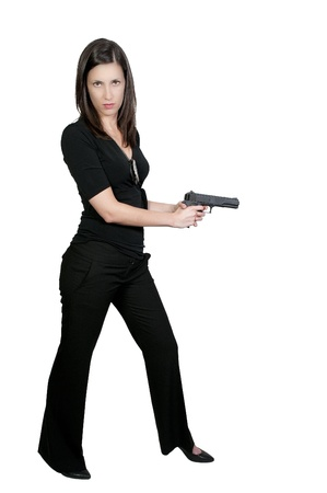 A beautiful police detective woman on the job with a gun Stock Photo - 9580999