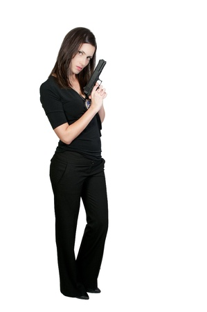 A beautiful police detective woman on the job with a gun Stock Photo - 9581799