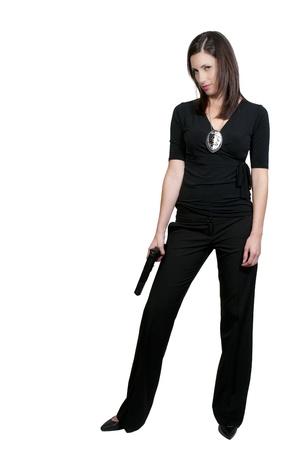 mujer policia: Una mujer detectives de la polic�a hermosa en el trabajo con una pistola Foto de archivo