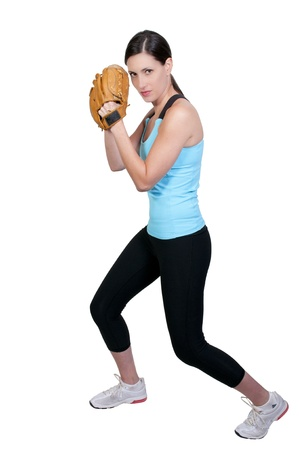 A beautiful woman throwing a baseball into the air photo