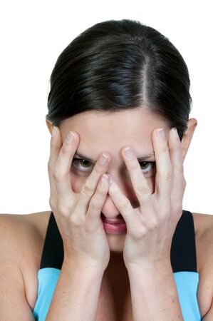 A beautiful young scared or surprized woman looking through her hands Stock Photo - 9582805