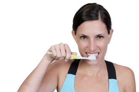 A beautiful woman practicing good oral dental care by brushing her teeth Zdjęcie Seryjne
