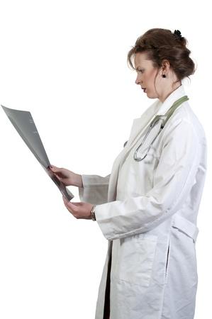 A beautiful female radiologist examining an x-ray Stock Photo - 9581384