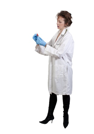sexy female doctor: A young beautiful woman doctor with a medical syringe with medicine Stock Photo