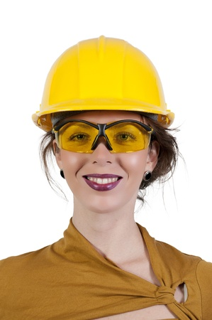 A Female Construction Worker wearing a hard hat and safety glasses Stock Photo - 9582809