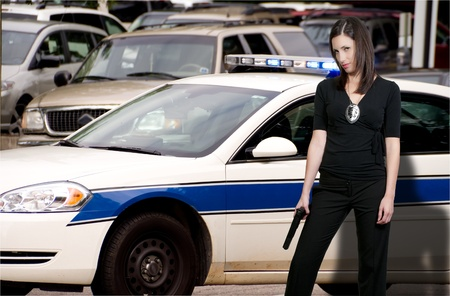 45 gun: A beautiful police detective woman out protecting and serving the public.