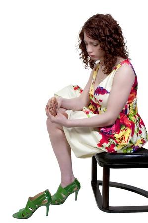 hand rubbing: A beautiful young business woman rubbing her sore tired feet Stock Photo