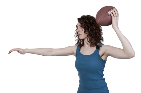beautiful young woman quarterback while throwing a football photo