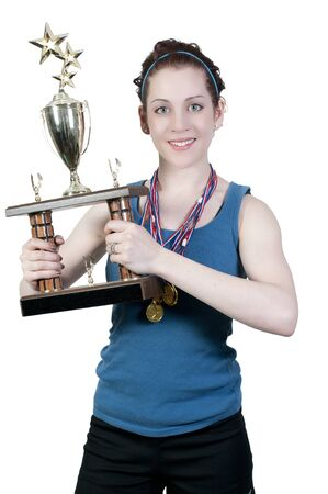 A beautiful woman wearing medals holding a large trophy photo