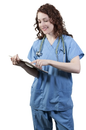 A beautiful young woman doctor or nurse holding a patient record Stock Photo - 9585890