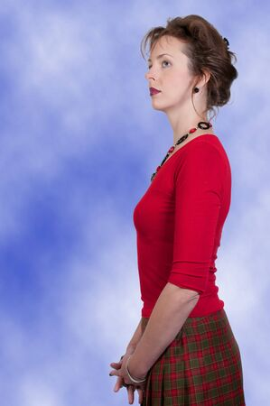 A beautiful young woman looking far away photo