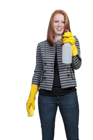 A glove wearing beautiful woman or maid cleaning house with a sponge and spray bottle with cleaner Stock Photo - 9578539