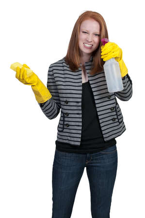 Aglove wearing beautiful woman or maid cleaning house with a sponge and spray bottle with cleaner Stock Photo - 9582428