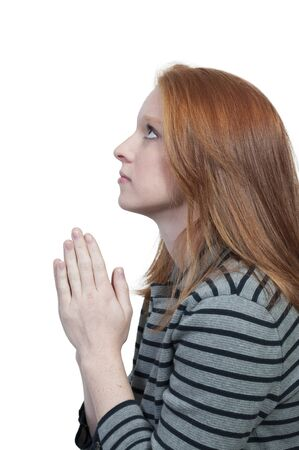 Beautiful Christian woman in a deep prayer Banque d'images