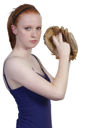 A beautiful woman baseball pitcher getting ready to throw a ball in a game photo