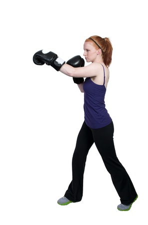 A beautiful young woman wearing a pair of boxing gloves Stock Photo - 9581101