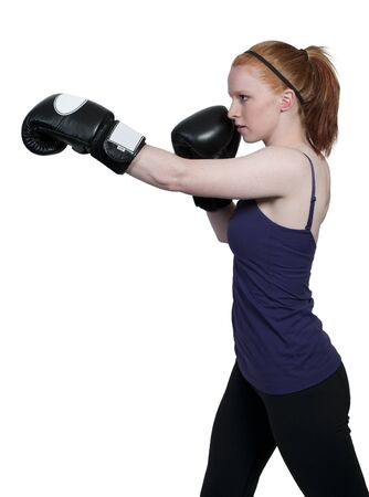 female boxer: A beautiful young woman wearing a pair of boxing gloves