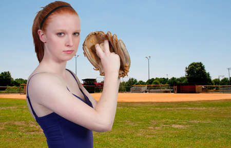 A beautiful woman pitcher getting ready to throw a ball photo