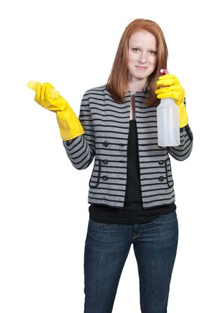 Aglove wearing beautiful woman or maid cleaning house with a sponge and spray bottle with cleaner Stock Photo - 9589334