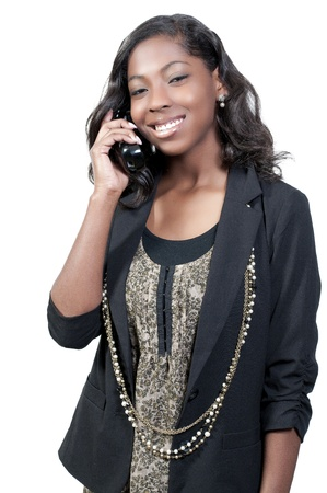 An African American teenage woman talking on the phone photo