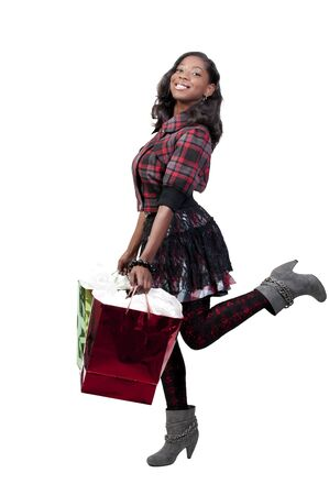 A young beautiful black African American teenage woman on a shopping spree photo