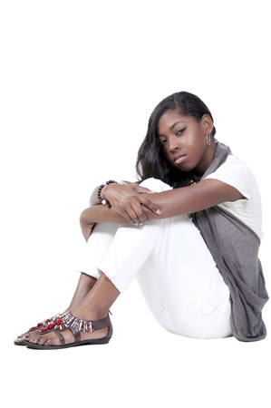 A beautiful young teenage African American woman suffering from the mental illness of depression photo