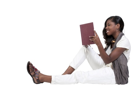 A young African American teenage woman reading a book photo